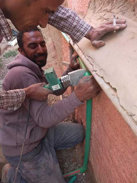 Rescuer building shelter in Egypt.